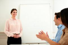 Business team giving applause on conference - stock photo
