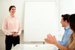 Professional group giving applause on meeting - stock photo