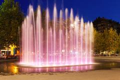 Fountain at town square in night. Sant Adria de Besos Stock Photos