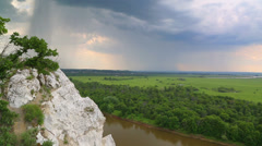 Stock Video Footage of landscape with river and rain on horizon - view from height