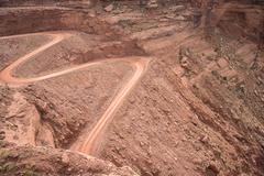 mineral bottom switchbacks dirt road - stock photo