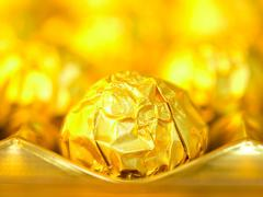 candy in gold wrappers - stock photo