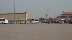 Tourists at tiananmen square waiting to see mao zedongs body Stock Footage