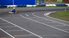 Go-kart in a curve front view Stock Footage
