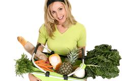 Female with eco shopping bag filled with groceries - stock photo