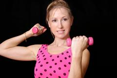 Firm and tone female with weights Stock Photos