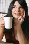 Beautiful woman with a mug of coffee Stock Photos