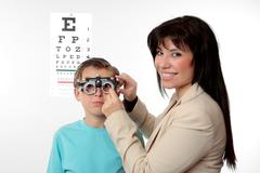 Optometrist and child patient - stock photo
