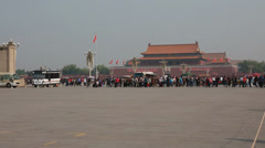 Tourists in tiananmen square waiting to see mao zedongs body Stock Footage