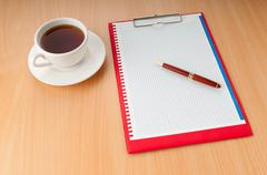 Binder with blank page and tea Stock Photos