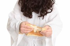 Jesus gave thanks and broke the bread..... - stock photo