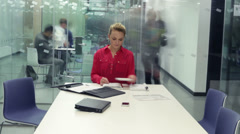 Timelapse of young attractive business group in a meeting in modern city office Stock Footage