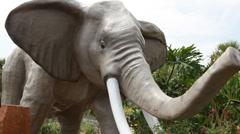 Elephant charging - statue at Jungle Golf Orlando Stock Footage