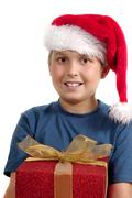 Christmas Giving boy with present - stock photo