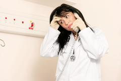 Medical dilemma worried doctor - stock photo