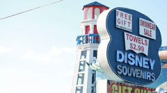 Disney souvenirs store sign with lighthouse behind Stock Footage