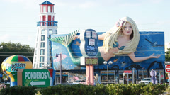 Mermaid, lighthouse and disney souvenirs signs in Orlando Stock Footage