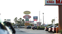 Store signs on Orlando strip mall across parking lot - stock footage