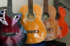 Ordered acoustic guitars Stock Photos
