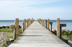 Wooden bath pier by the coast Stock Photos