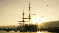 Historic HMS Warrior in Portsmouth at sunset Stock Footage