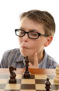 Chess player analyzing next move - stock photo