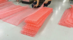 Stock Video Footage of  Labor cut Polyethylene Air Bubble for packing