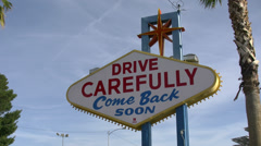Reverse view of the iconic Las Vegas Sign in Las Vegas Plane Takes Off - stock footage