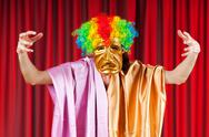 Theater concept with masked actor Stock Photos