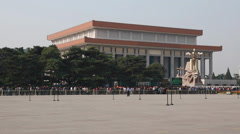 Tourists in tiananmen square in line to see mao Stock Footage