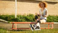 Stock Video Footage of Young girl with rollerblades drinking water