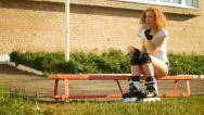 Stock Video Footage of Young girl with rollerblades drinking water, slowmotion video