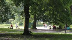 19 Park idyll. Park visitors enjoying sun and nature 2 - stock footage