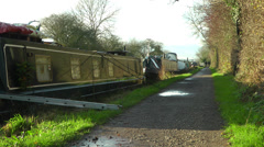 Canal boats moored by towpath Stock Footage
