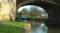Narrow boat through arch bridge Stock Footage