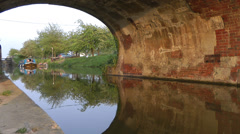 Arch bridge over canal reflected Stock Footage
