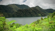 Stock Video Footage of White clouds over tropical lake, mountains and forest in the Philippines