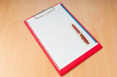 Binder with blank page with pen Stock Photos
