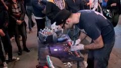 Street artist draws a picture by aerosol paints in Times Square Stock Footage