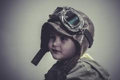 Stock Photo of aviation, fun and funny child dressed in aviator hat and goggles