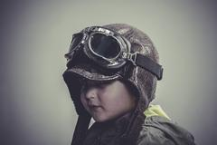 scarf, fun and funny child dressed in aviator hat and goggles - stock photo