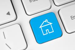Blue button with house on computer keyboard . Stock Illustration