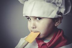 Nutrition child dress funny chef, cooking utensils Stock Photos