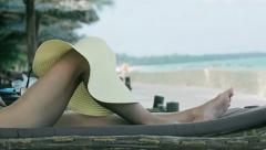 Hat hanging on woman legs Stock Footage