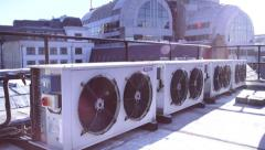 Pan Down Building to Air Con Units - stock footage