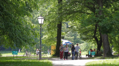 21 Park idyll. Park visitors enjoying sun and nature 4 Stock Footage