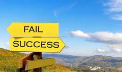close up of signpost fail and success - stock photo