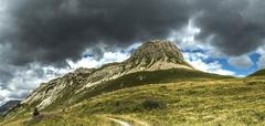 Storm clouds over the Mount Castellazzo - stock photo