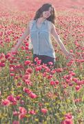 girl in poppies - stock photo