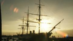 Sliding shot of Historic HMS Warrior at sunset Stock Footage